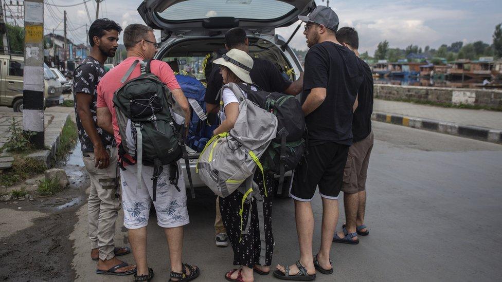 Tourists leaving Kashmir ahead of the lockdown