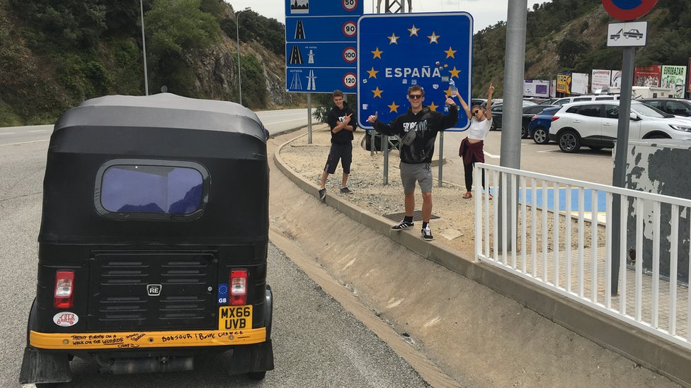 The Tuk Tuk and students at a roadside in Spain
