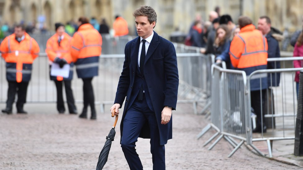 Eddie Redmayne arriving at funeral