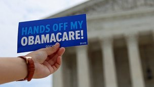 """Sign in front of the court reading """"hands off my Obamacare!"""""""