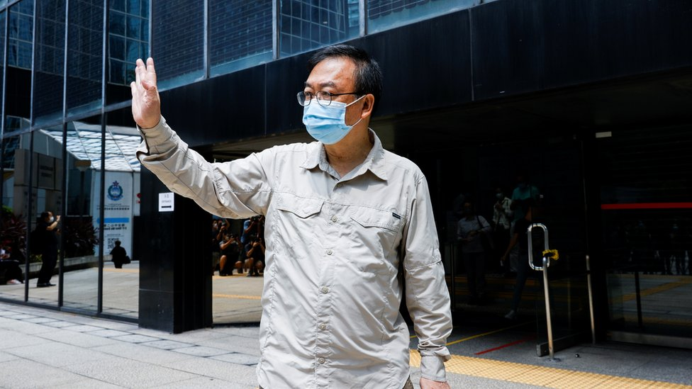 """Pro-democracy activist Cheung Man-kwong leaves the court after his sentence was suspended for participating in the assembly on June 4 to commemorate the 1989 crackdown on protesters in and around Beijing""""s Tiananmen Square, in Hong Kong, China, September 15, 2021. REUTERS/Tyrone Siu"""