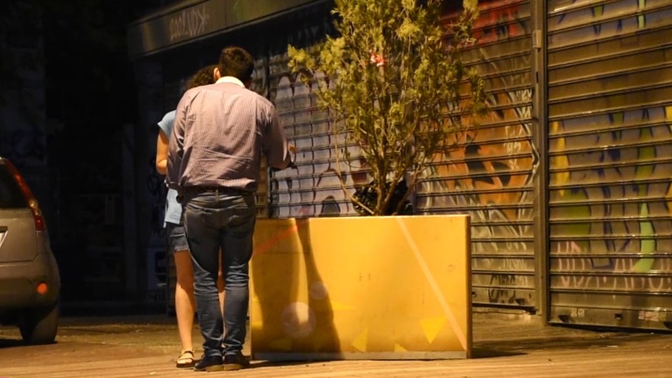 People are encouraged to engage in conversation on the streets of Athens, Greece