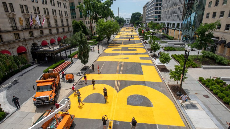 Black Lives Matter painted in yellow on the street leading up to the White House