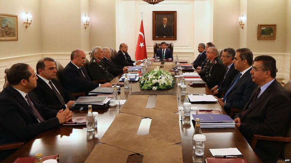 Turkey's Prime Minister Ahmet Davutoglu holds a security meeting