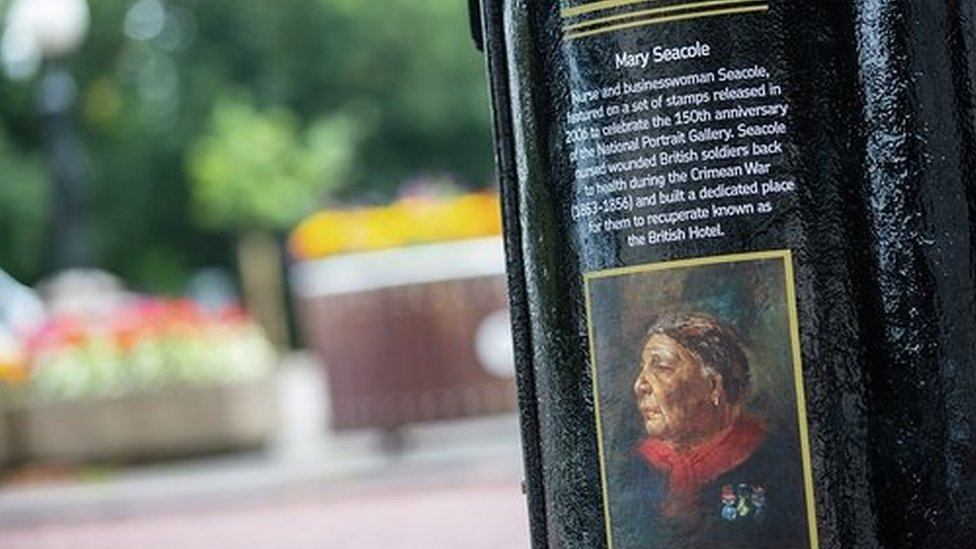 A black postbox featuring an image of Mary Seacole in King Edward VII Avenue, Cardiff