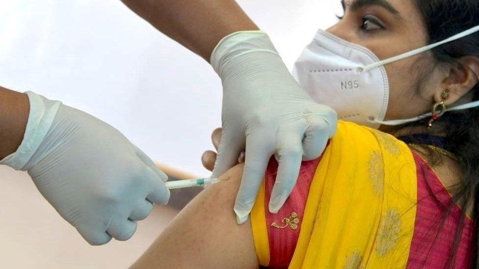 A volunteer receives the Covid-19 vaccine at a mock run in India's Karnataka