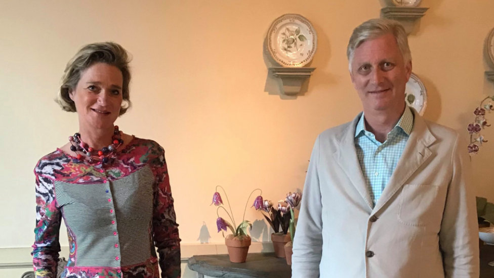 Belgian Princess Delphine (L) stands next to her brother, King Philippe