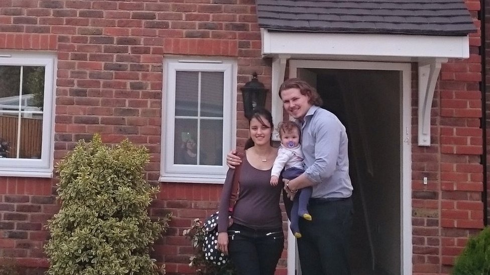 James Lowrey-English and his wife Jessica outside their new home