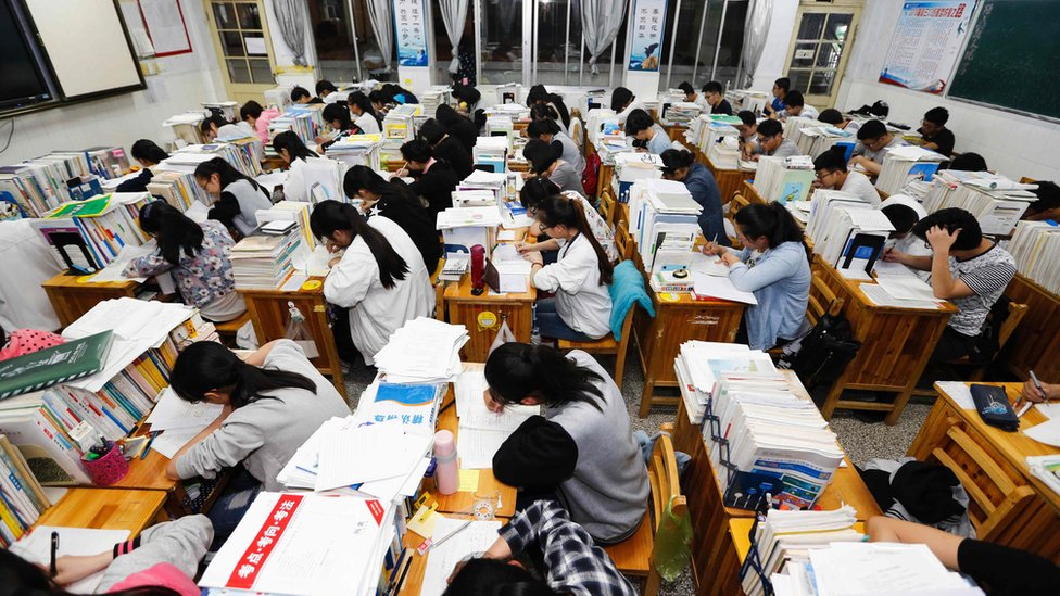 This photo taken on May 24, 2016 shows senior high school students studying at night to prepare for the college entrance exams at a high school