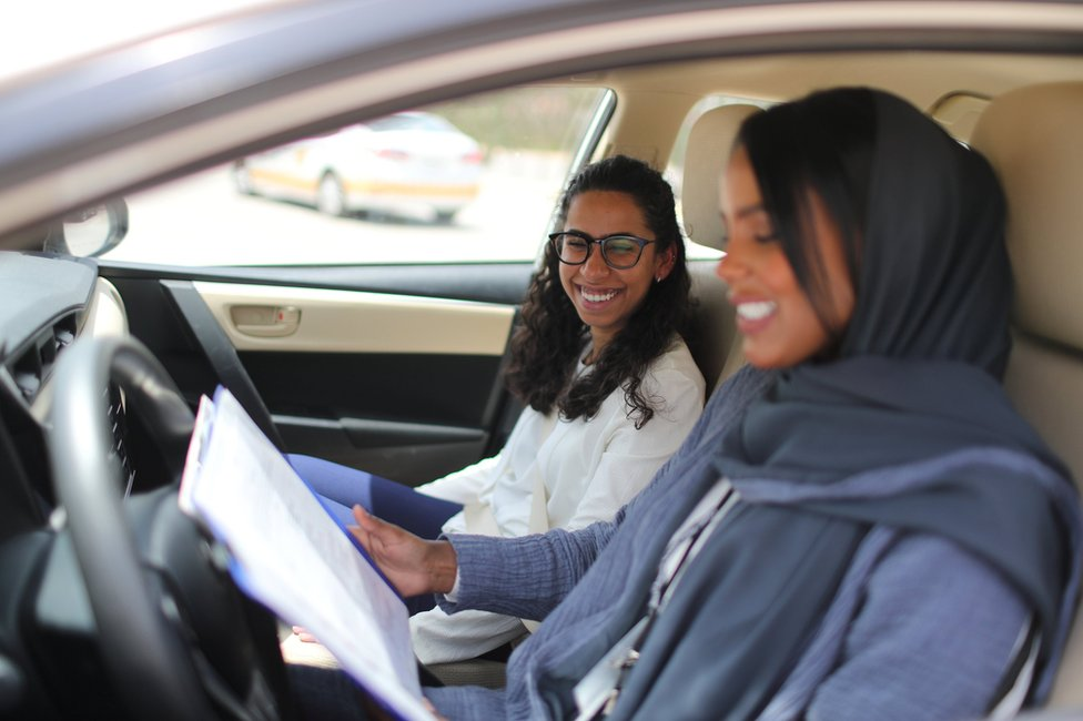Student Maria al-Faraj with driving instructor Ahlam al-Somali