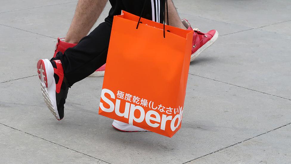 Superdry in profit warning after heatwave hits sales