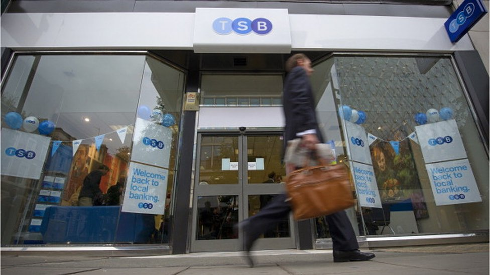 Man walking past TSB bank