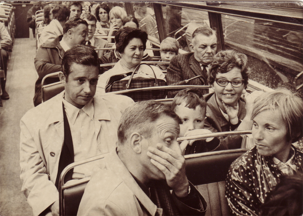 Mary and her husband on a London bus (third row back)