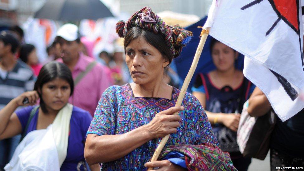 A women carrying a flag