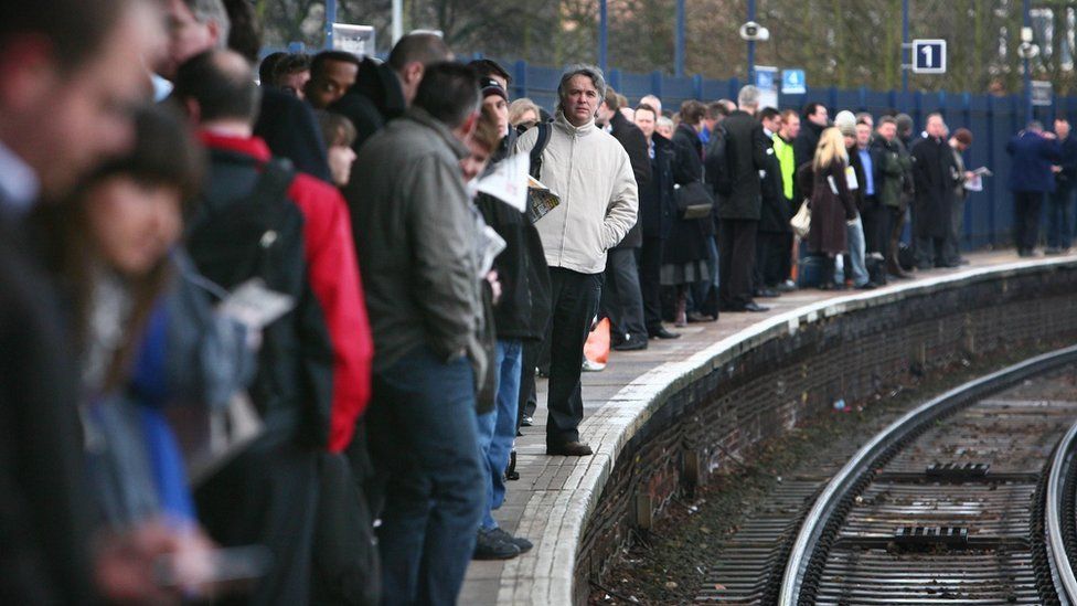 Commuters on a busy platform