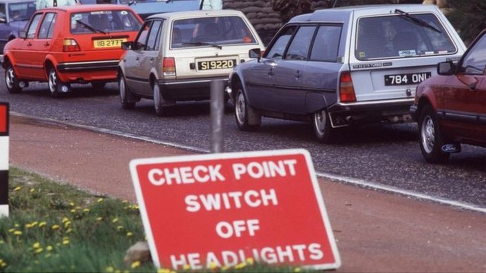 Cars at a vehicle checkpoint on the Irish border during the Northern Ireland Troubles