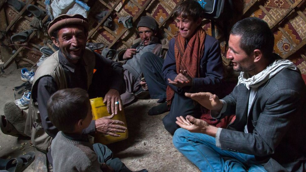 Wakhi nomads singing inside a yurt in Big Pamir, Afghanistan