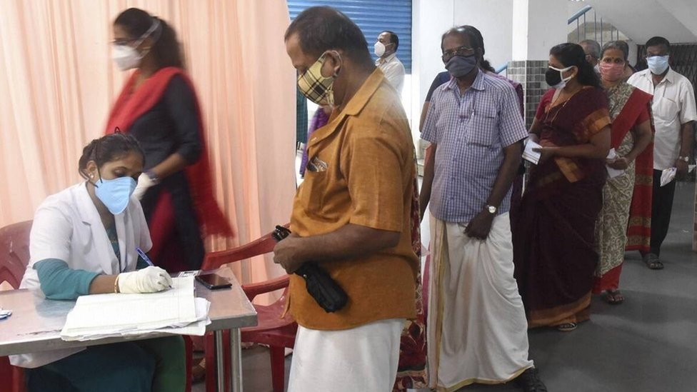 People queue up at a Covid-19 vaccination centre in Kochi on Wednesday