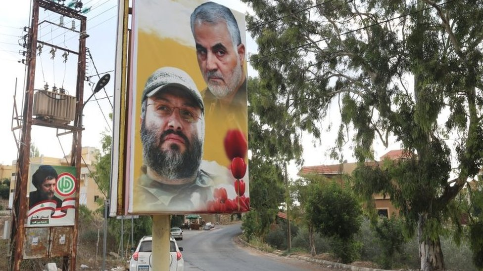 A banner showing the late Hezbollah military commander Imad Mughniyeh and the late Iranian general Qasem Soleimani in Ain Qana, Lebanon (22 September 2020)