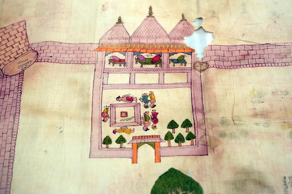 An old dilapidated map of Ayodhya depicting the birthplace of Lord Rama, being taken out from archives of erstwhile royal family of Jaipur, at City Palace, on August 11, 2019 in Jaipur, India.