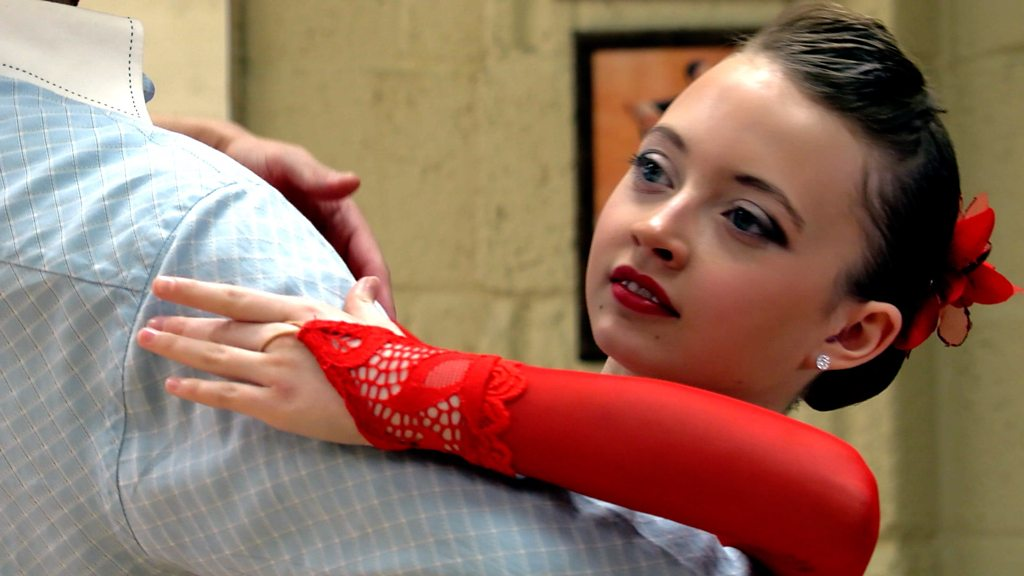 The 11-year-old ballroom dancer winning without a partner