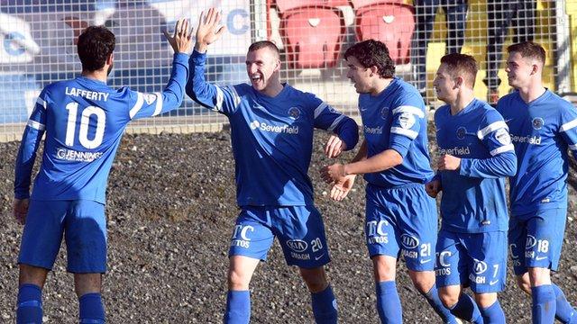 Ballinamallard players celebrate victory over Portadown