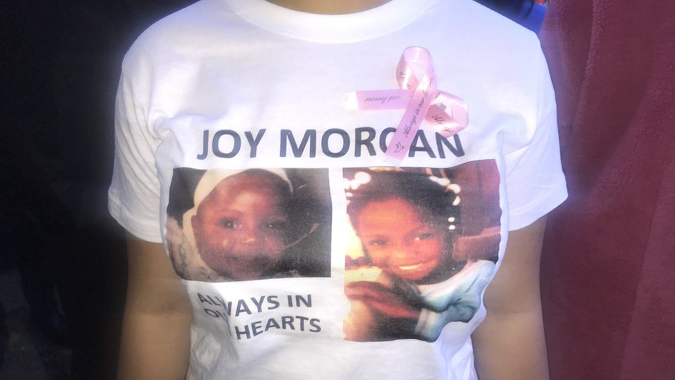A family member wearing a tribute T-shirt