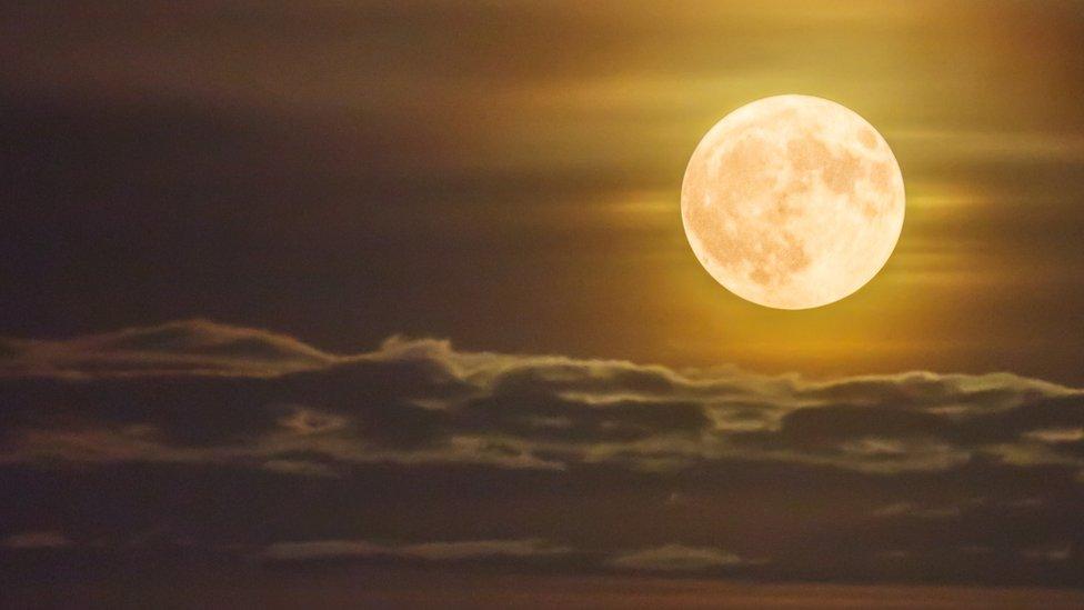 A shot of a bright orange supermoon