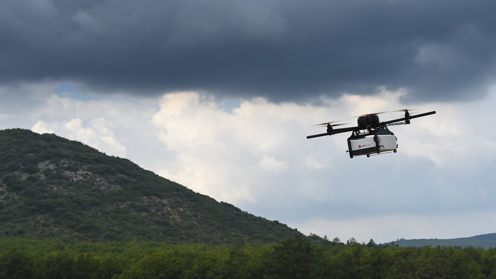 This picture taken on September 28, 2015 shows a Geopost drone flying in Pourrieres, southeastern France, during a presentation of a prototype of a package delivery drone.