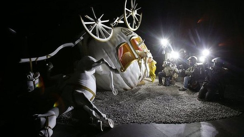 Overturned fairy carriage being photographed