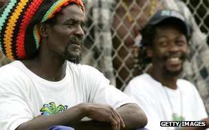 Groundstaff look on as the Australian cricket team train on the Caribbean island of St Vincent, 08 March 2007