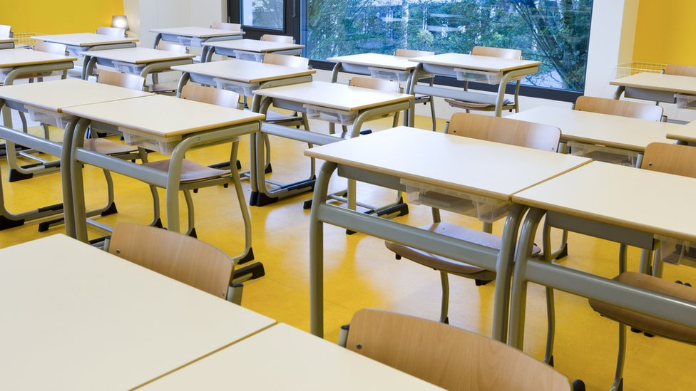 An empty classroom with rows of empty seats is seen in this file photo