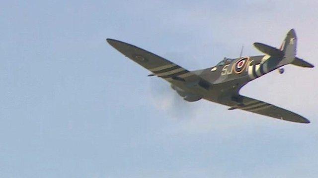 A Spitfire plane flying over London
