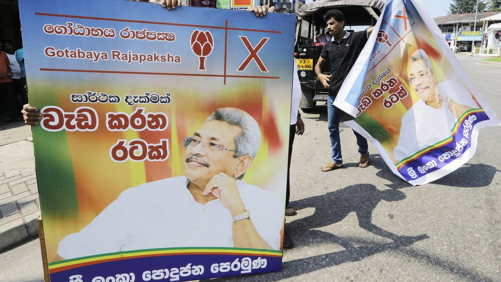 Supporters carrying Gotabaya Rajapaksa posters around Colombo after his win was announced
