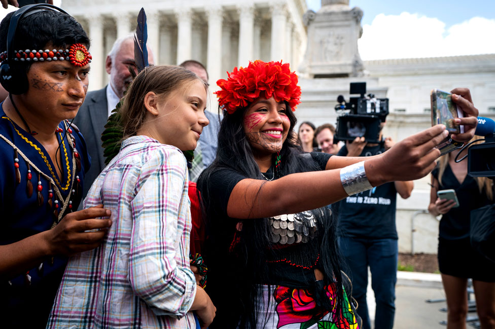 Climate activist Greta Thunberg poses for a selfie with Panamanian climate activist Militza Flaco outside the US Supreme Court in Washington DC, USA. 18 September 2019