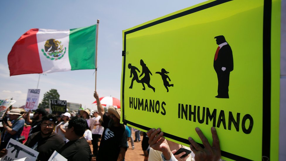 "Placard reads ""Humans and Inhuman"", El Paso, 7 August"