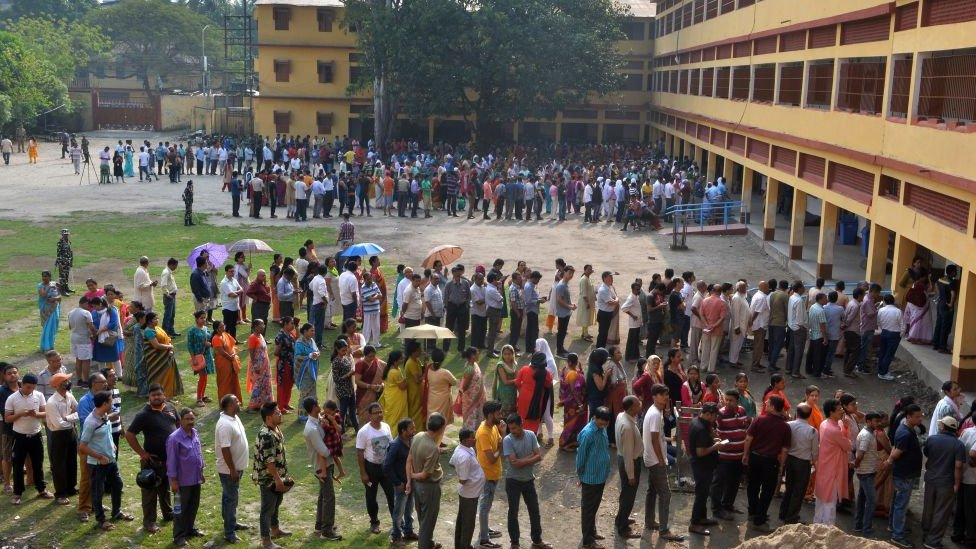 Indian voters queue up to cast their vote at a polling station in Siliguri, West Bengal on April 18, 2019, during the second phase of the mammoth Indian elections.