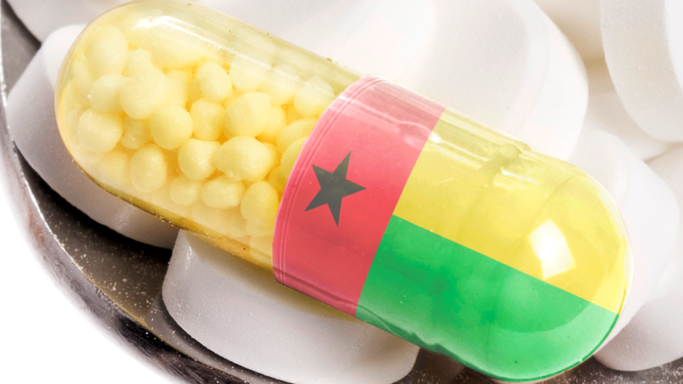 A stock image showing a drug capsule with the colours of Guinea-Bissau's flag