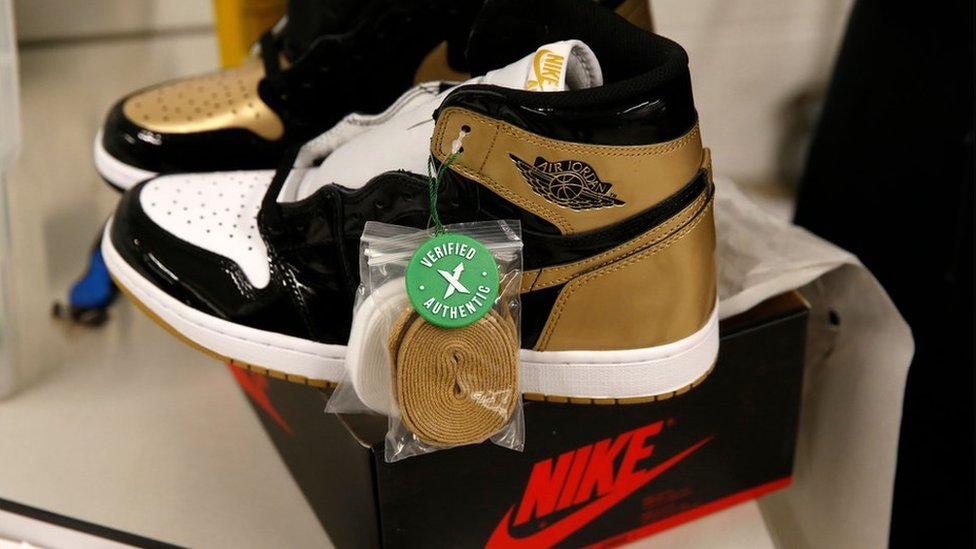 A pair of Air Jordan 1 Retro shoes are seen before being packed to ship out of StockX.