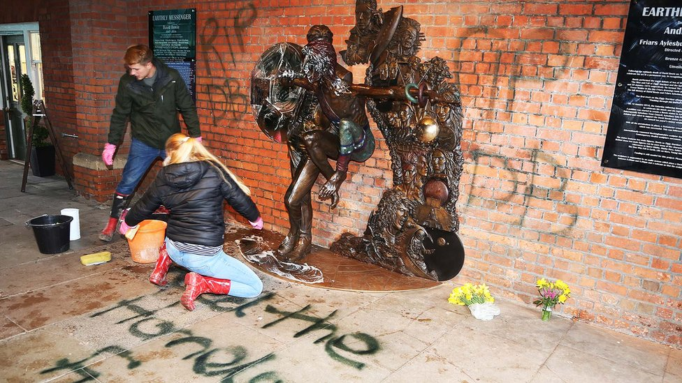Volunteers cleaning the David Bowie Statue