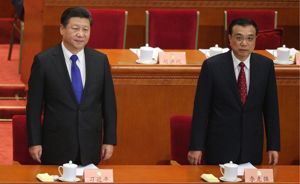 Chinese President Xi Jinping (L) and Chinese Premier Li Keqiang