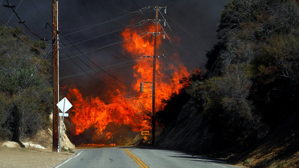 Flames from a wildfire are seen in Calabasas, California