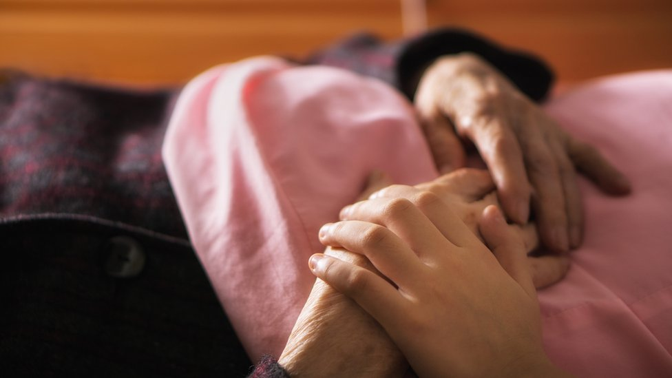 An elderly person being cared for