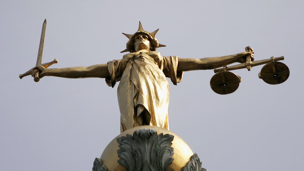Liberty with the scales of justice