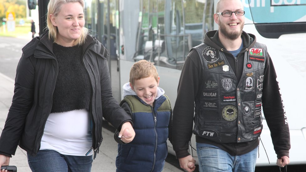 Alan walking with his parents