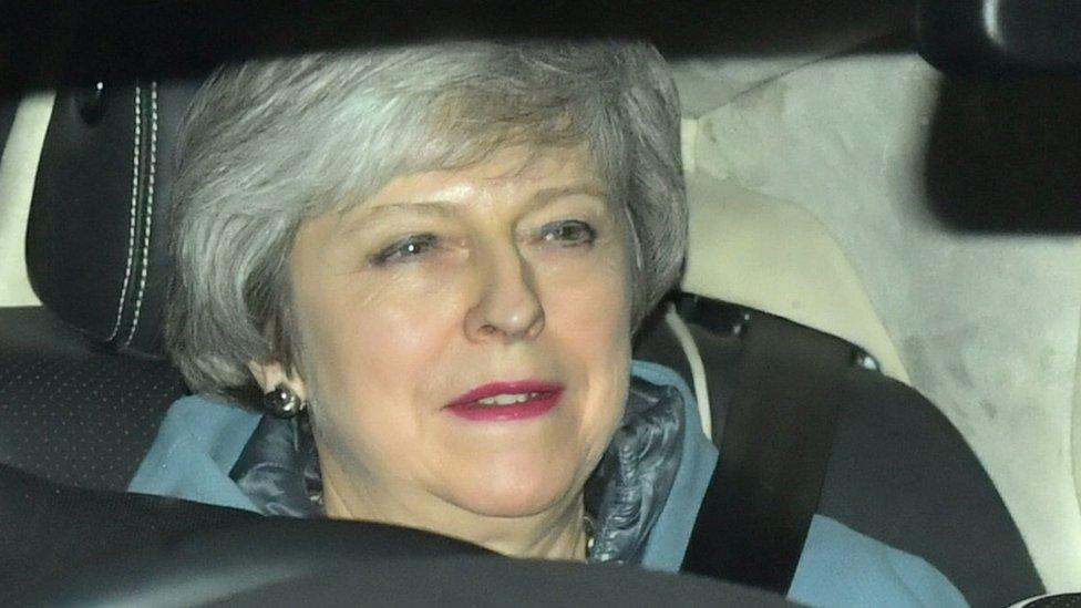 ماي في السيارة لدى خروجها من مجلس العموم