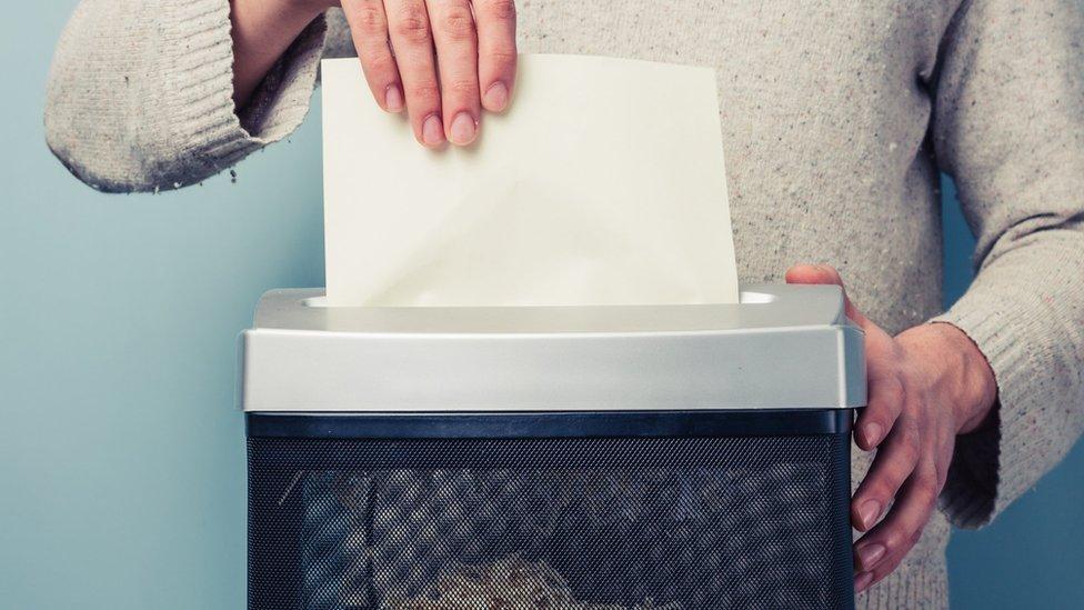 Documents in a shredder