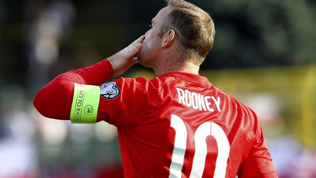 Wayne Rooney celebrates historic goal