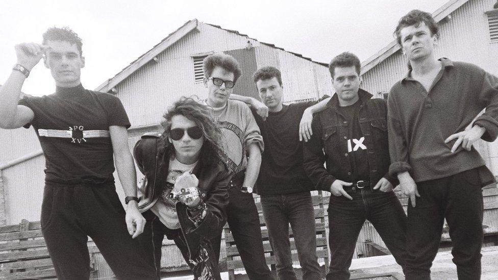 INXS in 1987 (L-R): Jon Farriss, Michael Hutchence, Kirk Pengilly, Garry Gary Beers, Andrew Farriss, Tim Farriss
