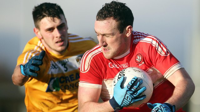 Antrim's Conor Burke tackles Derry's man of the match Shane Heavron at Owenbeg